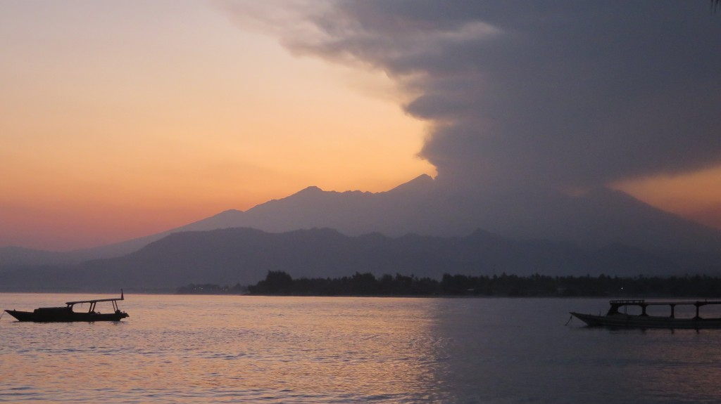Mount Rinjani spewing ash before sunrise